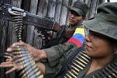 Two members of the FARC guerilla observe an army position prior to their ttack - Boris Heger - 24-06-2010