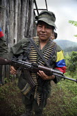 A women member of the FARC guerilla stands guard on the outskirts of their camp - Boris Heger - 24-06-2010