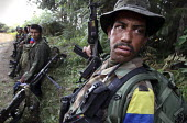 A group of the FARC guerilla take cover as they prepare to attack an army position - Boris Heger - 24-06-2010