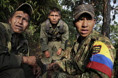A group of the FARC guerilla check the reaction of the enemy after they fired on an army position - Boris Heger - 24-06-2010