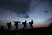 Members of the FARC moving position in the twilight. - Boris Heger - 24-06-2010