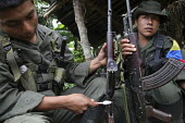 Members of the FARC guerilla clean and maintain their weapons during a rest. Using a toothbrush - Boris Heger - 25-06-2010