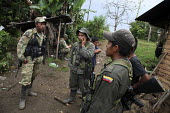 Members of the FARC guerilla chat together during a rest. - Boris Heger - 25-06-2010