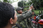 Members of the FARC guerilla playing with a pistol - Boris Heger - 25-06-2010