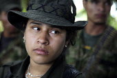 Members of the FARC guerilla hidden under trees to avoid detection by army helicopters. - Boris Heger - 26-06-2010