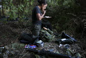 A woman member of the FARC guerilla putting on make up and suncream at camp. - Boris Heger - 26-06-2010