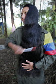 A woman member of the FARC guerilla combing her hair. - Boris Heger - 26-06-2010