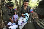 Woman members of the FARC guerilla check supplies of bras and underwear they have just received. - Boris Heger - ,2010,2010s,americas,Amerindian,Amerindians,armed,Armed Forces,arms,army,camp,camps,Civil War,Colombia,Colombian,Colombians,columbian,columbians,communism,Communist Party,communists,conflict,conflicts