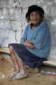 A poor indigenous woman siting in a village in a region where FARC guerila groups are operating regularly, Columbia - Boris Heger - 2010,2010s,age,ageing population,americas,Amerindian,Amerindians,Colombia,Colombian,Colombians,columbian,columbians,country,countryside,elderly,EQUALITY,excluded,exclusion,FARC,FEMALE,HARDSHIP,impover