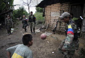 Members of the FARC guerilla play football with local indigenous children in a village in the jungle. - Boris Heger - 25-06-2010