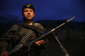 Women members of the FARC guerilla with an M2 Browning ready for a long night march to avoid being spotted by the army. - Boris Heger - ,2010,2010s,americas,Amerindian,Amerindians,armed,Armed Forces,arms,army,at,belt,Bullet,bullets,Civil War,Colombia,Colombian,Colombians,columbian,columbians,communism,Communist Party,communists,confli