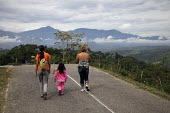People walk in the outskirts of San Cristobal, Venezuela. The deteriorating security situation in the regions on the border with Venezuela and Columbia has led to more than 15000 seeking refuge in the... - Boris Heger - 2010,2010s,adult,adults,americans,americas,Amerindian,Amerindians,armed,border,child,CHILDHOOD,children,cities,city,Colombia,Colombian,columbian,columbians,Diaspora,displaced,displacement,families,fam