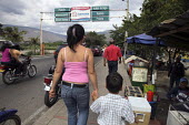 People cross the main border post separating Colombia and Venezuela, to the Venezuelan state of Tachira and San Cristobal. The deteriorating security situation in the regions on the border with Venezu... - Boris Heger - 2010,2010s,adult,adults,americans,americas,Amerindian,Amerindians,armed,border,boy,boys,child,CHILDHOOD,children,cities,city,Colombia,Colombian,columbian,columbians,Diaspora,displaced,displacement,FAM