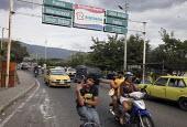 People cross the main border post separating Colombia and Venezuela, to the Venezuelan state of Tachira and San Cristobal. The deteriorating security situation in the regions on the border with Venezu... - Boris Heger - 2010,2010s,americans,americas,Amerindian,Amerindians,armed,border,cities,city,Colombia,Colombian,columbian,columbians,Diaspora,displaced,displacement,FARC,foreign,foreigner,foreigners,guerilla,Guerill