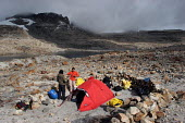 Tourists camp at the Laguna Grande, at the feet of the mountain range of El Cocuy, culminating at a height of 5400 meters, Colombia.. The region, not far from the border with Venezuela, used to be out... - Boris Heger - ,2000s,2007,americas,armed,border,camp,camper,campers,camping,camps,colombia,Colombian,Colombians,country,countryside,eni environmental issues,Guerilla,Guerillas,Guerrilla,Guerrillas,height,holiday,ho