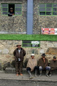 Local farmers take a rest in front a bar, near the village of El Cocuy, in the mountain range of the same name Colombia. - Boris Heger - ,2000s,2007,agricultural,agriculture,americas,bar,bars,break,capitalism,capitalist,colombia,Colombian,Colombians,EBF Economy,everyday,farm,farm worker,farm workers,farmer,farmers,farmhand,farmhands,fa