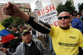 Protesters holding colombian flags and anti-Bush boards take to the street as President Bush meets his colombian counterpart Alvaro Uribe, in Bogota, March 11, 2007, Colombia. - Boris Heger - 11-03-2007