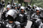 Riot policemen get ready as protesters took to the streets while President Bush meets his colombian counterpart Alvaro Uribe, in Bogota, March 11, 2007, Colombia. It is estimated that around 1500 pros... - Boris Heger - 11-03-2007