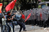 Protesters clash with anti riot policemen as they try to force their way to the city center, where President Bush meets his colombian counterpart Alvaro Uribe, in Bogota, March 11, 2007, Colombia. It... - Boris Heger - 11-03-2007
