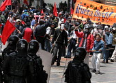 Protesters face riot policemen as they try to force their way to the city center, where President Bush meets his colombian counterpart Alvaro Uribe, in Bogota, March 11, 2007, Colombia. It is estimate... - Boris Heger - 11-03-2007