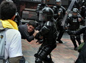 A protester is being arrested by riot policemen after throwing stones at them while President Bush meets his colombian counterpart Alvaro Uribe, in Bogota, March 11, 2007, Colombia. It is estimated th... - Boris Heger - 2000s,2007,activist,activists,adult,adults,against,americas,anti,arrest,arrested,ARRESTING,Bogota,Bush,CAMPAIGN,campaigner,campaigners,CAMPAIGNING,CAMPAIGNS,CLJ,colombia,Colombian,Colombians,confront,