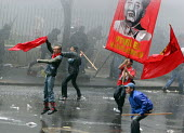 Protesters resist water cannons as they clash with anti riot policemen trying to force their way to the city center, where President Bush meets his colombian counterpart Alvaro Uribe, in Bogota, March... - Boris Heger - 11-03-2007