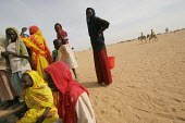 Women displaced by the violence wait their turn to fetch water, IDP camp of Gereida, Darfur region, Sudan, May 2006. - Boris Heger - 05-05-2006