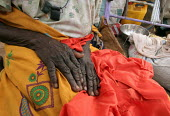 Detail of the hands of a woman displaced by the violence, IDP camp of Gereida, Darfur region, Sudan, May 2006. - Boris Heger - 05-05-2006