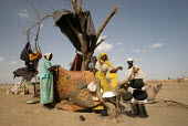 A family displaced by the violence live in a shelter under a tree, IDP camp of Gereida, Darfur region, Sudan, May 2006. - Boris Heger - 05-05-2006
