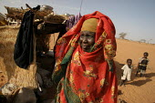 Woman displaced by the violence in front of her shelter, IDP camp of Gereida, Darfur region, Sudan, May 2006. - Boris Heger - 05-05-2006