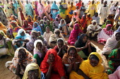 Women displaced by the violence wait for a food distribution, IDP camp of Gereida, Darfur region, Sudan, May 2006. - Boris Heger - 06-05-2006