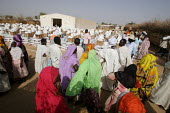 People displaced by the violence wait for a Red Cross food distribution, IDP camp of Gereida, Darfur region, Sudan, May 2006. - Boris Heger - 06-05-2006