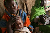 Mothers displaced by the violence watch their children at a malnutrition rehabilitation center, IDP camp of Gereida, Darfur region, Sudan, May 2006. - Boris Heger - 06-05-2006