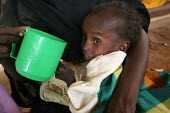 A child displaced by the violence is being fed by her mother at a malnutrition rehabilitation center, IDP camp of Gereida, Darfur region, Sudan, May 2006. - Boris Heger - 06-05-2006
