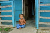Colombian child refugee in front of her new home, Yape, Darien region, Panama, 2004. This region is very remote. - Boris Heger - 25-08-2006