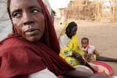 A woman and her family displaced by the violence, IDP camp of Gereida, Darfur region, Sudan, May 2006. - Boris Heger - 2000s,2006,agencies,agency,aid,assistance,camp,camps,charitable,charities,charity,displaced,displacement,EQUALITY,excluded,exclusion,families,family,FEMALE,genocide,giving,HARDSHIP,help,helping,HELPS,
