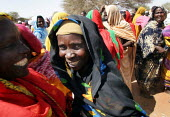 Women laughing in the arab village of Malam, Darfur region, Sudan, May 2006. - Boris Heger - 30-05-2006