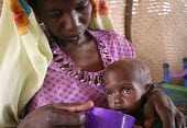 A child displaced by the violence is being fed by his mother at a malnutrition rehabilitation center, IDP camp of Gereida, Darfur region, Sudan, May 2006. - Boris Heger - 07-05-2006