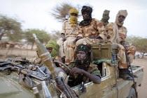 Rebels from the SLA-Z branch in theirjeep, near Muzbat, Darfur region, Sudan, May 2006. - Boris Heger - 11-05-2006