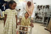 War wounded children learning to walk with their new orthopaedic prosthesis with their assistant and mothers watching, orthopaedic center, Khartoum, Sudan, 2006 - Boris Heger - 28-05-2006