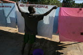 A hospital worker puts bedsheet to dry up in the sun, Juba Teaching Hospital, South Sudan, May 2006. - Boris Heger - 25-05-2006