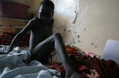 A boy on his bed in the childrens ward, Juba Teaching Hospital, South Sudan, May 2006. - Boris Heger - 25-05-2006