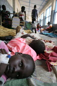 Sick children wait on the crowded floor for being attended, Juba Teaching Hospital, South Sudan, May 2006. - Boris Heger - 23-05-2006