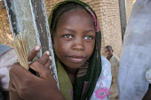 A young girl, Adre, Eastern Chad, right on the border with the Darfur region of Sudan. October 2005. Adre is known to be a very unstable and unsafe place as it was attacked many times by Darfur Janjaw... - Boris Heger - 2000s,2005,army,border,Chad,Chadian,child,CHILDHOOD,children,Civil War,conflict,conflicts,Diaspora,displaced,EQUALITY,excluded,exclusion,female,females,foreign,foreigner,foreigners,girl,girls,HARDSHIP