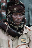 A Chadian army soldier in Adre, Eastern Chad, right on the border with the Darfur region of Sudan. October 2005. Adre is known to be a very unstable and unsafe place as it was attacked many times by D... - Boris Heger - ,2000s,2005,Armed Forces,army,border,Chad,Chadian,conflict,conflicts,janjaweed,military,PEOPLE,region,rural,SERVICE,SERVICES,Social Issues,soi,soldier,soldiers,Sudanese,UCW