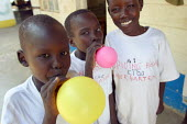 South Sudanese war wounded boys play with balloons in the Red Cross Lopiding Hospital, Lokichokio, Northern Kenya, December 2003. The hospital was the main medical facility for people in South Sudan f... - Boris Heger - 03-12-2003