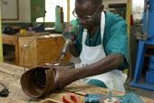 Local employees of the orthopaedic center prepare artificial legs, in the Red Cross Lopiding Hospital, Lokichokio, Northern Kenya, December 2003. The hospital was the main medical facility for people... - Boris Heger - 03-12-2003