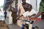 A South Sudanese war wounded boy play with a bike in the Red Cross Lopiding Hospital, Lokichokio, Northern Kenya, December 2003. The hospital was the main medical facility for people in South Sudan fo... - Boris Heger - 03-12-2003