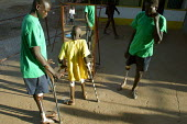 South Sudanese war wounded try and learn to walk with their new orthopaedic legs in front of a mirror at the Red Cross orthopaedic center, Lopiding Hospital, Lokichokio, Northern Kenya, December 2003.... - Boris Heger - 03-12-2003