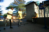 South Sudanese war wounded try and learn to play football with their new orthopaedic legs in front of a Red Cross orthopaedic center, Lopiding Hospital, Lokichokio, Northern Kenya, December 2003. The... - Boris Heger - 03-12-2003
